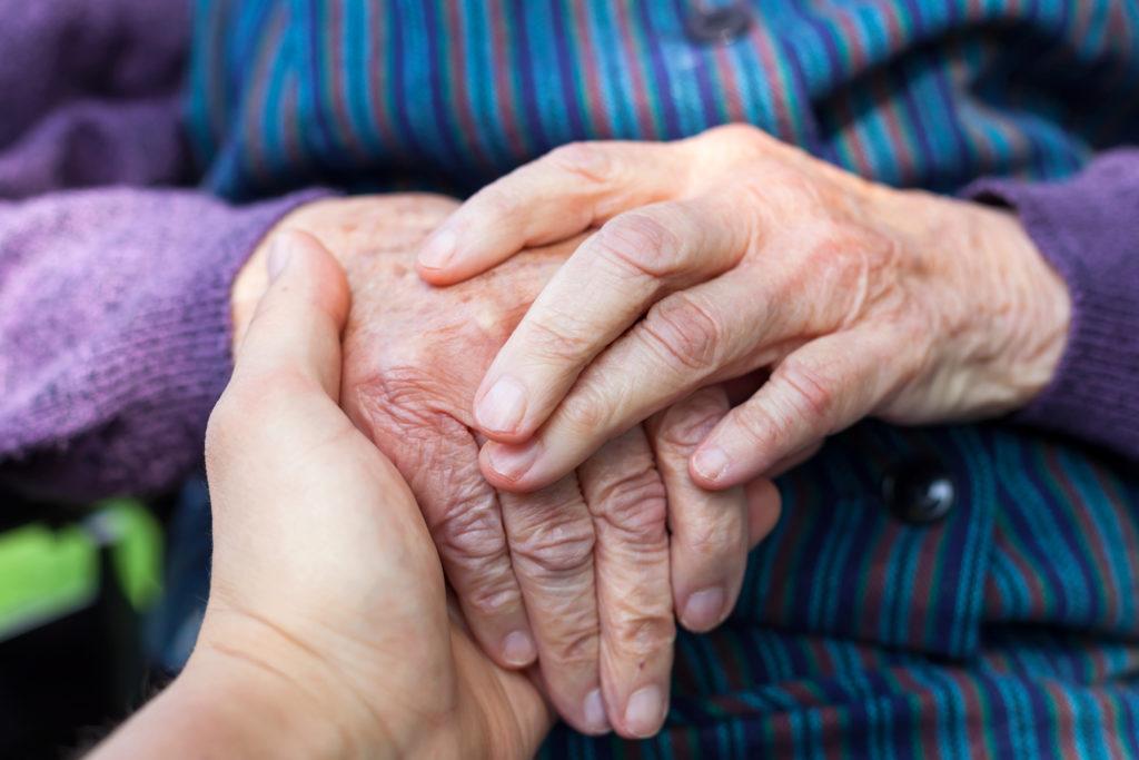 Holding Elderly female hands